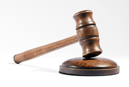 sentencing: Wooden gavel as used by a judge when pronouncing a verdict and sentencing or by an auctioneer to knock down an auction lot on a white background Stock Photo