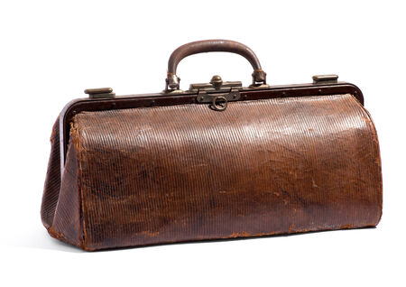 holdall: Old brown doctors bag or holdall with a textured surface viewed closed with the handle raised up isolated on white in a medical and healthcare concept