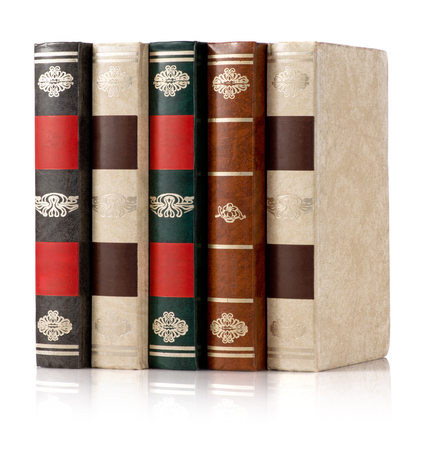 tooled: Five classic books standing upright in a row on a reflective white surface with gilt tooled spines with copyspace for your titles Stock Photo