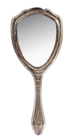 toilette: Vintage silver ladies handheld toilette mirror on isolated on white with a grey reflection in the glass