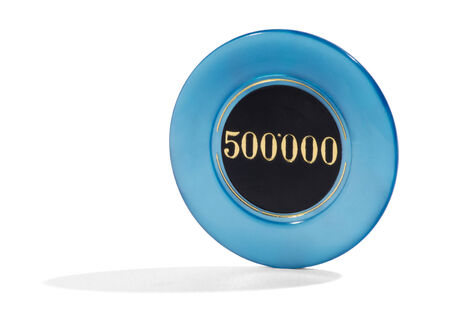 bets: 500000 blue casino chip or token used to place bets standing upright on a white background with copyspace Stock Photo