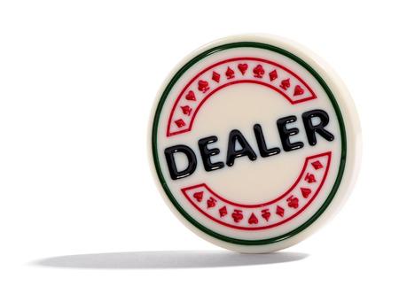 designate: Dealer poker chip, button or marker used to designate the rotating or nominal dealer
