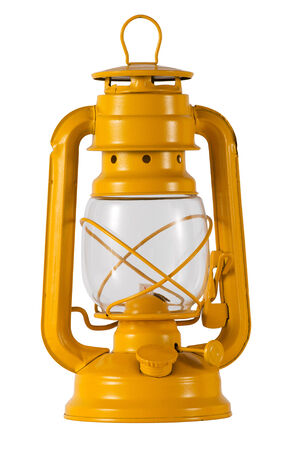 hurricane lamp: Yellow metal oil or paraffin hurricane lamp or lantern with a glass chimney and metal cover to protect against the wind, also known as a storm lantern