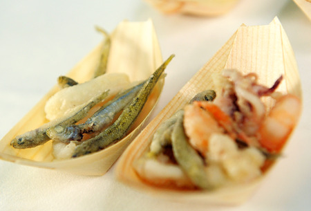 catered: Servings of small fried fish on a catered buffet in individual boat shaped dishes at a special event or celebration Stock Photo