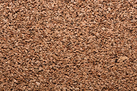 impermeable: Background texture of a natural cork panel made from the inner bark of a tree used in construction for insulation due to its fire resistant qualities Stock Photo