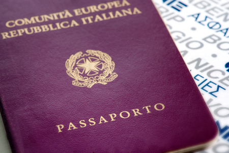 citizenship: Close up view of the exterior cover of an Italian passport in a travel and citizenship concept Stock Photo