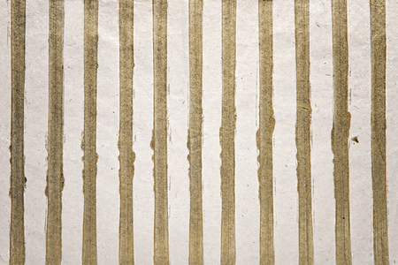 gold textured background: Gold stripes background of glitter on a textured white background for a special occasion or celebration