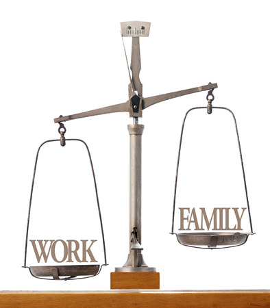 Old pan scale showing the importance of work versus family time in imbalance with work weighted as the priority over spending time with the family
