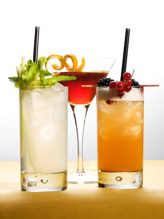 mouth watering: Different Cold Mouth Watering Drinks on Glasses with Fresh Fruits and Leaves. Captured with White Background. Stock Photo
