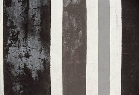 alternating: Zebra wall background texture and pattern with alternating grey, white and black vertical stripes of different widths Stock Photo