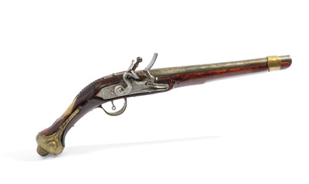 flintlock: Antique wooden flintlock pistol with silver mechanism viewed from the side isolated on white