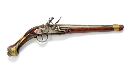 flintlock: Side view of a single barrel antique wooden flintlock pistol with silver mechanism on a white background