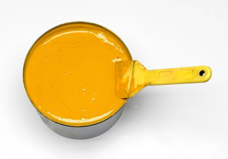 gamut: Close up Shot of Conceptual Yellow Ink in a Can with Brush Isolated on White Background.