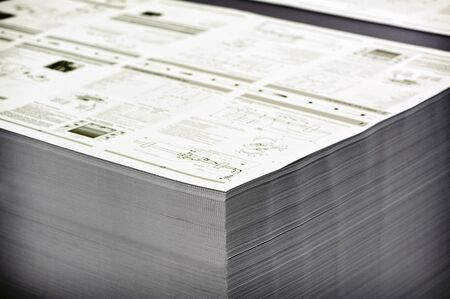collate: Close up Pile of Printed White Documents Inside the Office, Ready for Delivery. Stock Photo