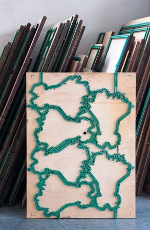 die cut: Close up Pile of die cut mold wooden board cutter Inside the Office