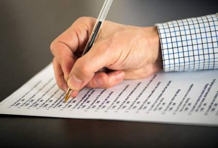 multiple choice: Close up fo the hand of a man completing a questionnaire Stock Photo