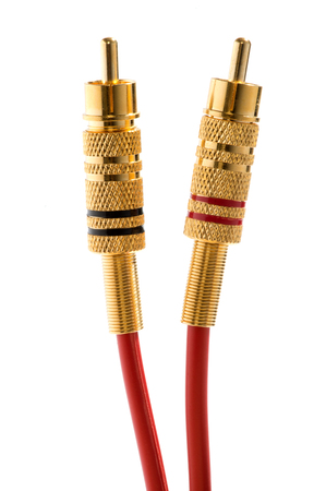 rca: Set of two color coded brass RCA connectors and cables for transmitting audio and video signals to home entertainment systems such as VCRs and televisions isolated on white Stock Photo