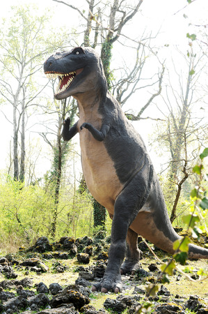 bipedal: Three Quarter View of Model of Tyrannosaurus Rex Dinosaur, a Bipedal Carnivore from Late Cretaceous Period in Outdoor Theme Park