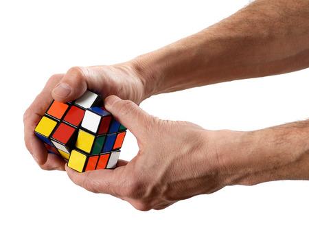 twisting: Man twisting a puzzle cube