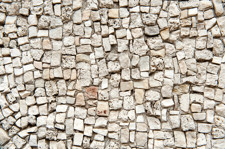 varying: Architectural Detail of Stone Wall with White Stones of Varying Sizes Shapes and Textures Ideal for Backgrounds