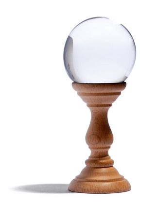 foresee: Glass globe for fortunetelling and predicting the future on a wooden stand over a white background with a shadow and copyspace Stock Photo
