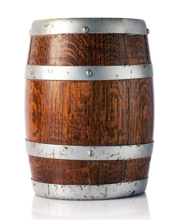 maturing: Coopered wooden oak barrel with metal bands for storage and maturing of wine, beer or brandy in a cellar or winery, close up view over white