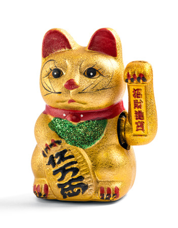 denoting: Gilded Chinese, Asian or Feng Shui lucky charm cat with a paw raised in greeting denoting wealth and prosperity over a white background