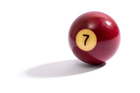 side lighting: Number 7 snooker ball with the number visible casting a shadow from side lighting on a white background with copyspace Stock Photo
