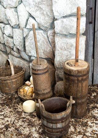 Old bucket and churn tools for making cheese