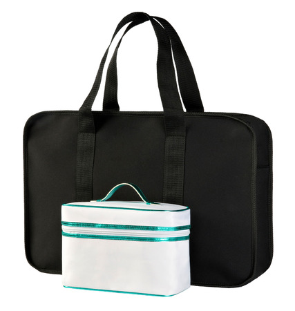 vanity bag: Two beauty or vanity bags for carrying female toiletries, cosmetics and makeup isolated on white, one small white and one larger black