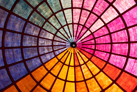 roof framework: Bright vibrant colored roof interior with radiating rays of color and a concentric circular framework in a dynamic architectural background