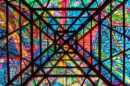 roof framework: Architectural colored roof design with a square framework and abstract vivid multicolored pattern in the colors of the rainbow in a symmetrical view Foto de archivo