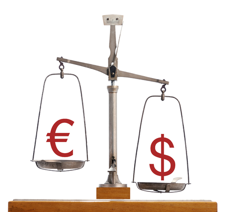 valued: Euro Dollar scale - Dollar strength with the currency symbols balanced on a vintage scale with the Dollar weighted down valued higher on forex and capital markets, financial concept