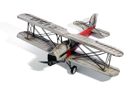 high scale: Scale model of a vintage biplane with a single propeller engine and double decker wing structure above and below the fuselage, high angle view