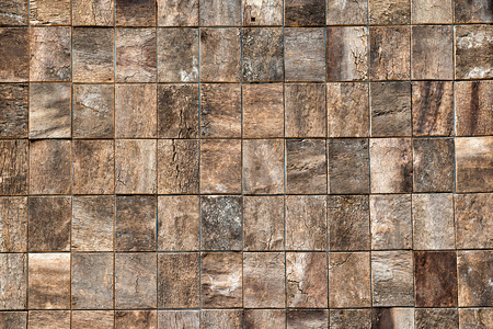 woodgrain: Wooden bricks background texture with small equilateral square bricks in parallel rows with decorative natural woodgrain pattern, full frame