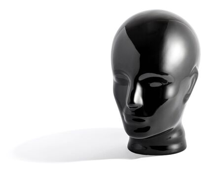 featureless: Still Life of Shiny Black Featureless Mannequin Face Statue Against White Background in Studio with Copy Space