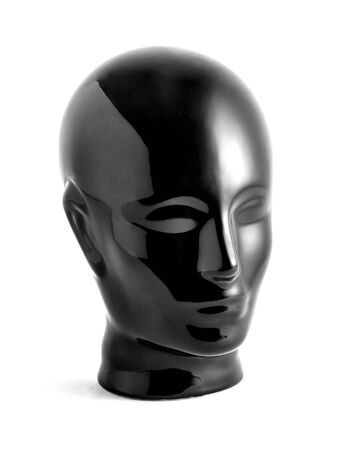 featureless: Still Life of Shiny Black Featureless Mannequin Face Statue Against White Background in Studio