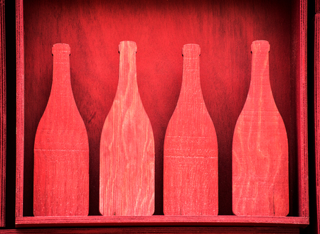 outs: Four Red Wooden Bottle Silhouette Cut Outs in Red Box - Decorative Feature of Wooden Wine Bottles
