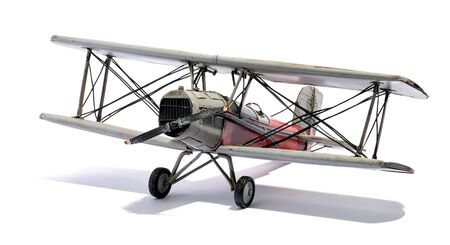 doubledecker: Model of a vintage biplane with a double-decker wing structure and single propeller engine viewed angled from the front with a shadow over white