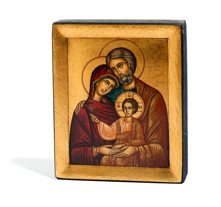 gilded: Gilded painted wooden religious icon of Joseph, Mary and the baby Jesus in a plain rectangular frame isolated on a white background