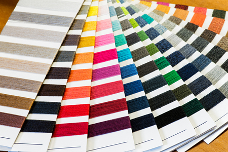 cotton thread: Textile Still Life Background - Cotton Thread Color Samples Fanned Out in Colorful Array