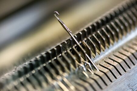 Knitting machine single needle closeup