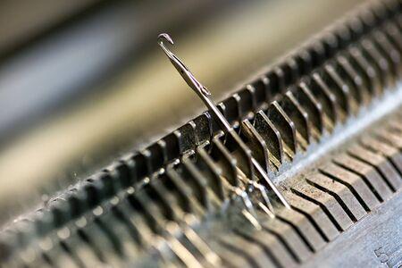Knitting machine single needle closeup