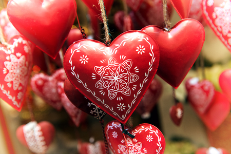 Hanging Red Decorated Metal Hearts Symbolic Of Love And Romance