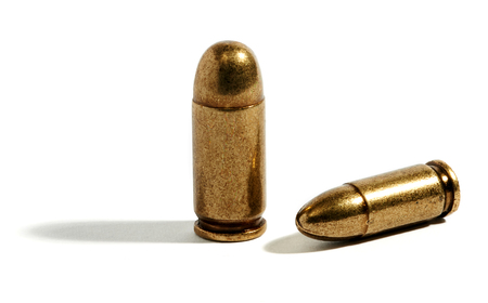 casings: Two hollow point yellow bullets laying down and standing up over white background