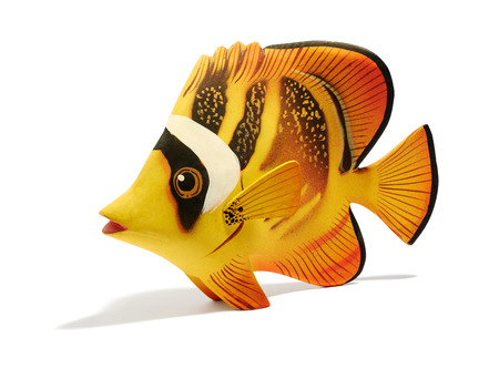 model fish: Cute single little exotic yellow wooden fish model over white background