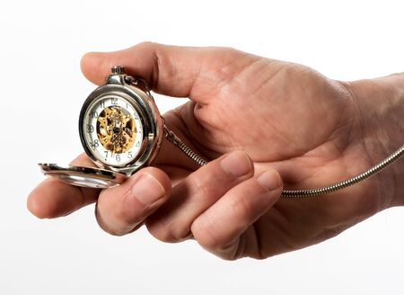 hunter man: Man holding a vintage silver full hunter pocket watch in his hand opened to display the bronze mechanism through the glass dial, isolated on white