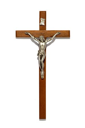 roman catholic: Plain wooden crucifix with silver figure of Christ, a religious and spiritual symbol of the Roman Catholic church and Christianity, isolated on white