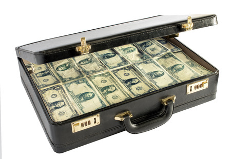 Black leather briefcase packed with money with the lid raised to show stacks of dollar bills conceptual of a ransom, wealth, savings, finances, bribe or money laundering