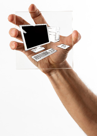 hand held computer: Single square clear glass display with computer symbol held tightly in human hand over white background